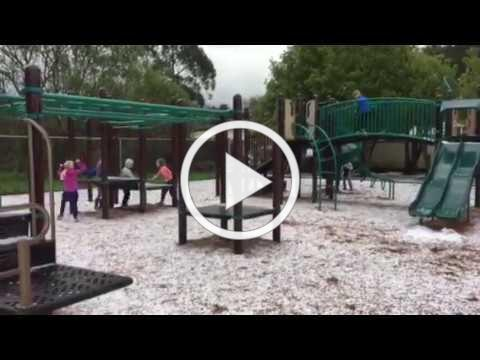 Second graders playing in the hail!