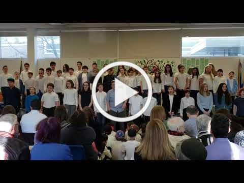 The Middle Schoolers Sing Shalom Aleinu at the Chanukah Assembly