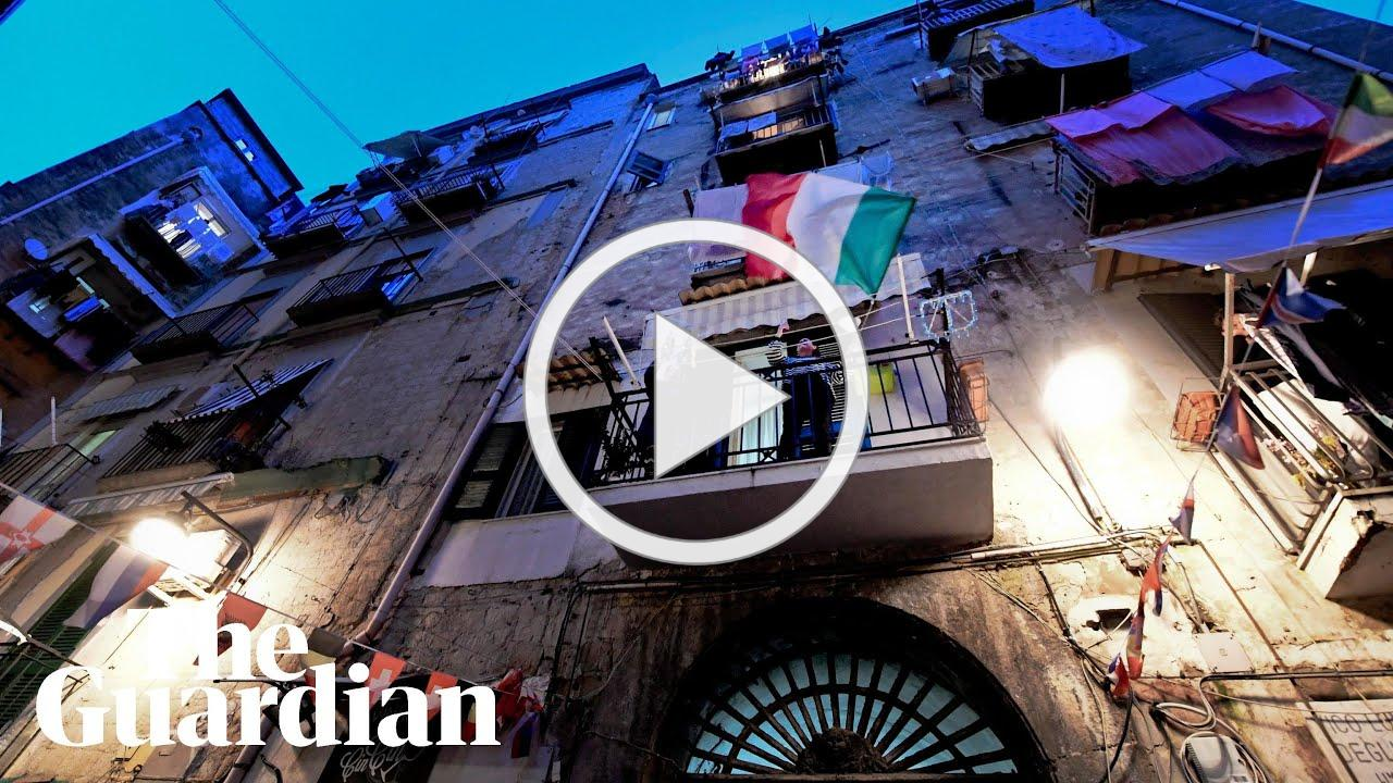 Coronavirus: quarantined Italians sing from balconies to lift spirits