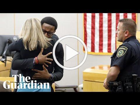 Botham Jean's brother hugs ex-officer Amber Guyger after sentencing