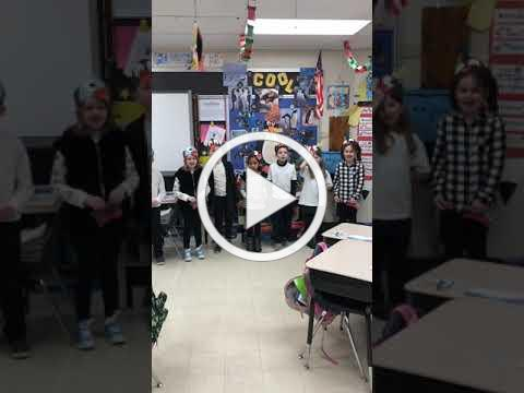 """Our first graders singing about penguins on """"Penguin Day""""!"""