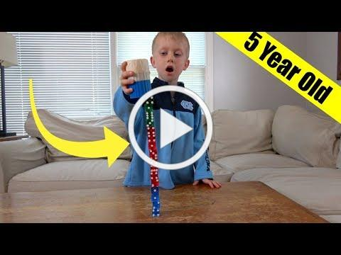 Dice Stacking Trick Shots by a 5 Year Old!   That's Amazing
