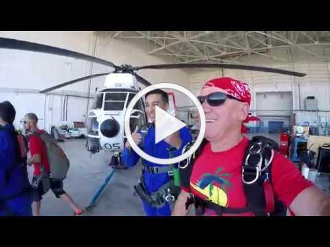 Skydive Guam's Vasili Mladinov celebrates his 26,000th jump with a Håfa Adai Pledge