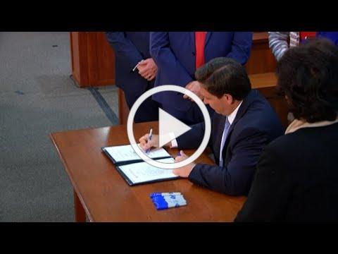 Gov. Ron DeSantis signs COVID-liability bill into law