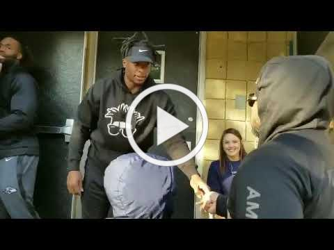 Baltimore Ravens Give Away 200 Turkeys at Wolfe Street Academy