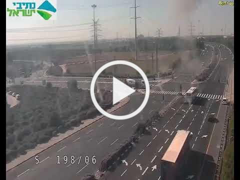 Traffic cam shows rocket hitting intersection in central Israel