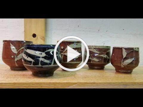 How I apply wax resist decoration to pots. Background music compliments of Ozzie dog!