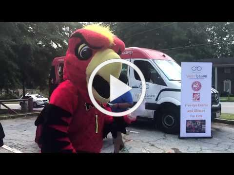 Harry The Hawk plays with Kids at COSF Back 2 School Celebration